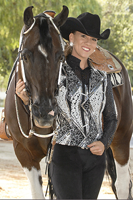 "Black basics are beautiful in the show ring when carefully crafted and coordinated. Here, Hobby Horse's ""Zydeco"" vest in black and white pairs with a diamond patterned saddle blanket for a winning fashion statement. Photo ©2015, Hobby Horse Clothing Co., Inc."