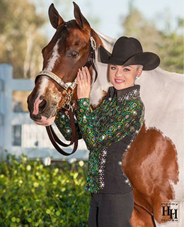 The Hobby Horse Artemis Takeaway Ten Green Show Jacket has lush sequined center panels and sleeves that pair with black stretch side panels to create the illusion of a smaller waistline when your ride or compete in halter events. The jeweled side bands and collar add extra drama.